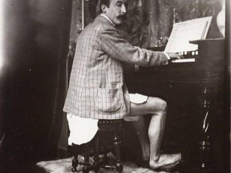 Paul Gauguin Playing the Harmonium in Alfons Mucha 's Studio at rue de la Grande-Chaumière, Paris, c. 1895
