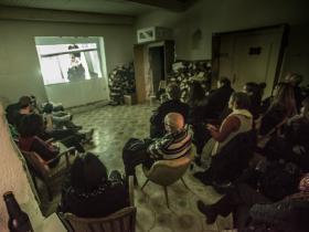Guests watching doc film (by Cana Bilir-Meier & Julian Stockinger)